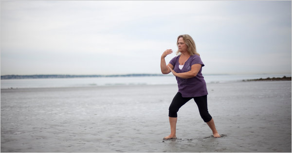 Mary Petersen, who has been suffering from Fibromyalgia, practicing tai chi on Nahant Beach, Mass., near her home. Credit: Jodi Hilton for The New York Times